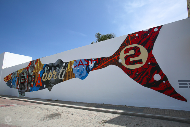 1xRun and PangeaSeed paint mural in Isla Mujeres with Vexta, Meggs, Saner, Curiot, Tristan Eaton, Tatiana Suarez, Aaron Glasson, Pelucas, Celeste Byers, Sharktoof, Hannah Stouffer, Smithe, Nosego